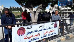 متقاعدو الأمن العام يعلقون اعتصامهم